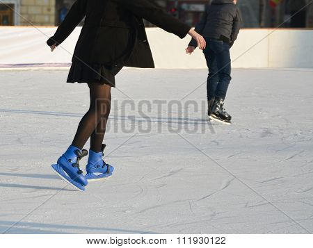 Young Girl In Skirt Ice Skating