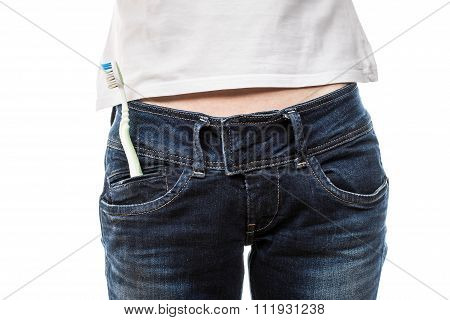 Female hips in blue jeans