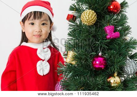 Asian Chinese Little Girl Posing With Christmas Tree