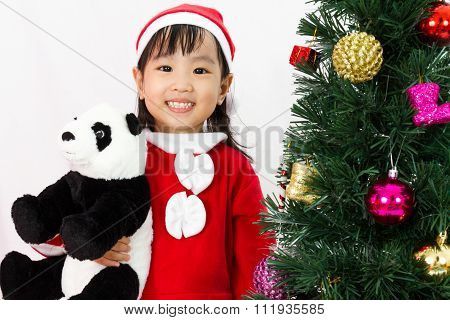 Asian Chinese Little Girl Holding Panda Doll Posing With Christmas Tree