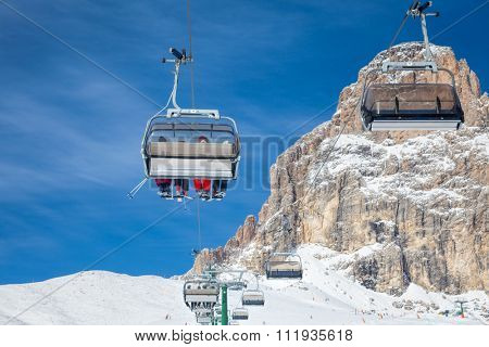 Chair lift with skiers at ski resort