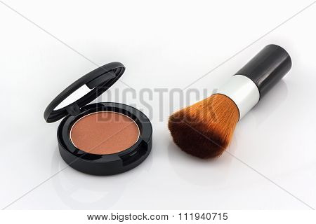 Closeup Of Face Powder And Makeup Brush.