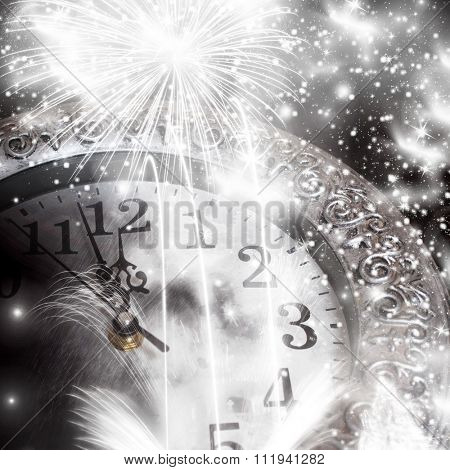 Old clock at twelve o'clock with fireworks and holiday lights - New Year's at midnight