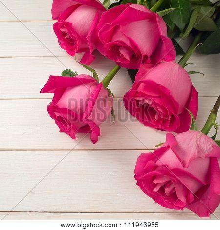 Hybrid Tea Roses On The White Planks Background