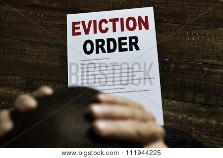a young caucasian man with his hands in his head concerned because has just received an eviction order