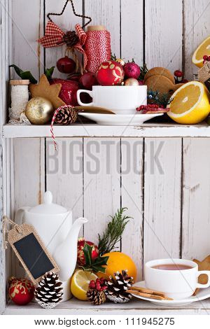 Christmas still life in a shabby chic cupboard