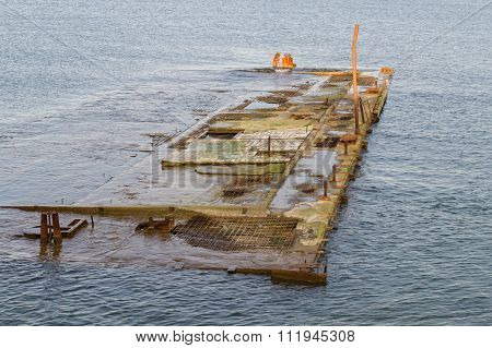 Abandoned Quay Submerged In Water