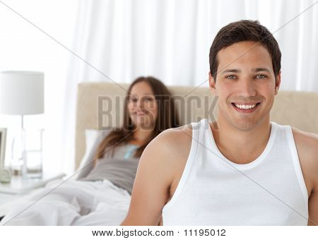 Handsome Man On The Edge Of The Bed With His Girlfriend