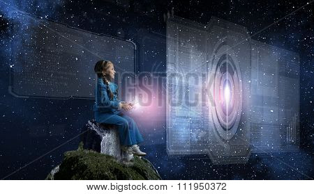 Little girl sitting on top and playing with joystick