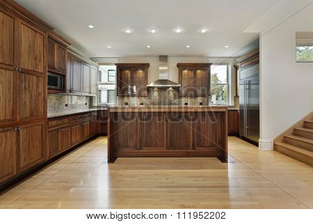 Kitchen in new construction home with wood cabinets