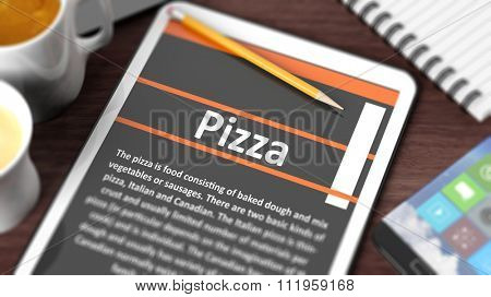 Tabletop with various objects focused on tablet with recipe of