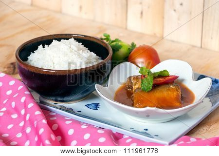 Sardines Fish In Tomato Sauce With Cooked Rice On Wooden Table
