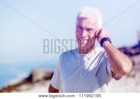 Sports and music. man getting ready for jogging and listening to the MP3 player