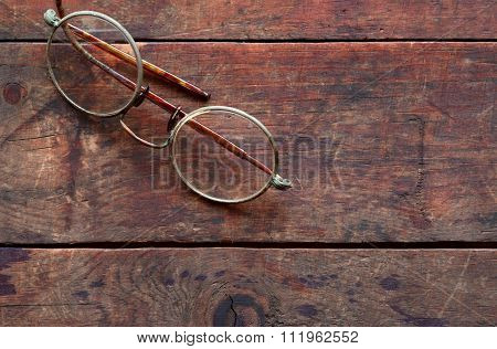 Old Spectacles On Wood