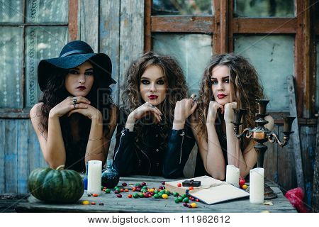 three witches at the table