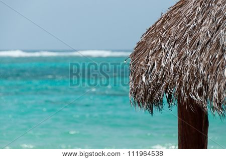 The Native Roof made of leave facing the blue caribbean ocean on Little Corn Island