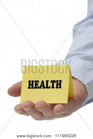 Business man holding yellow health sign on hand