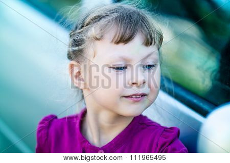 little girl admiring themselves in the mirror