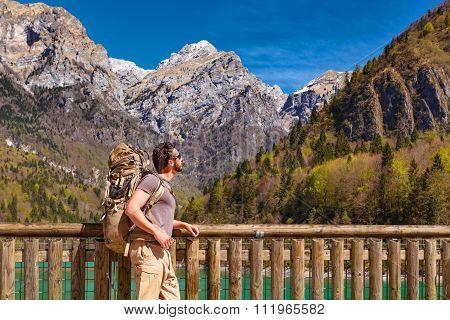 Hiker At The Lakeside Enjoying The Landscape