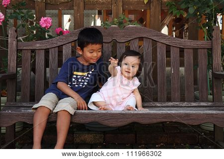 Japanese brother and sister hugging each other (6 years old boy and 1 year old girl)