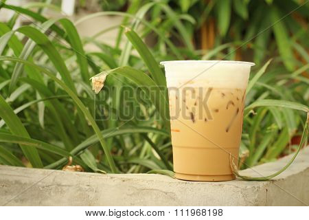 Iced Coffee On Cement At The Park.