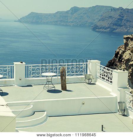 Beautiful White Terrace Overlooking Sea In Oia, Santorini, Cyclades, Greece