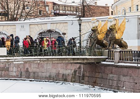 Tourists And Townspeople At Griffon Sculpture Of Bank Bridge