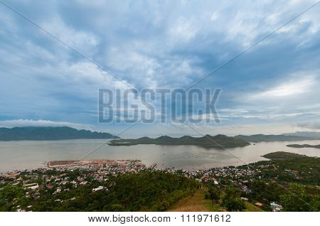 Blue clouds and sky over small village Coron at the sea on island Palawan