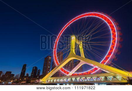 Night Scene Cityscape Of Tianjin Ferris Wheel,tianjin Eye With Dark Blue Background. Tianjin Eye Is