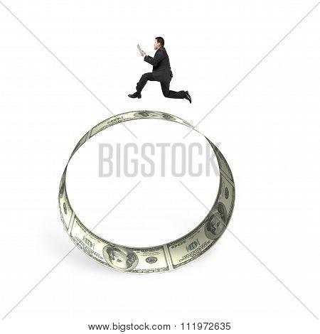 Man Holding Smart Tablet Running On Circle Of Dollar Bills