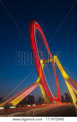 Night Scene Cityscape Side View Of Tianjin Ferris Wheel ,tianjin Eye With Dark Blue Background.