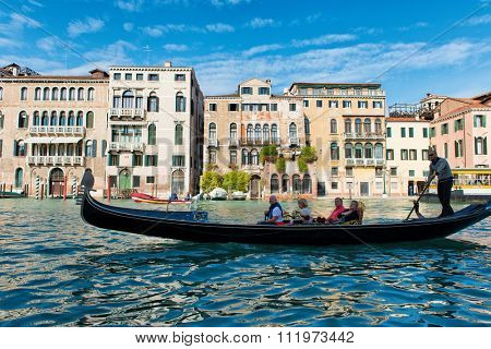 VENICE, ITALY - 17 OCTOBER 2015: Gondola rowed by the gondolier on a romantic sightseeing tour of the Grand Canal, Venice, Italy on 17 October 2015.