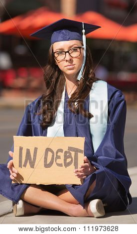 Graduate Sitting With Debt