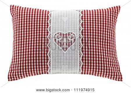 Closeup of a red gingham pillow with flake of Swiss stone pine inside, decorated with hand-made vintage crochet lace, isolated on white background