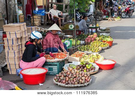 Vietnamese women are selling fruits at the wet market in Nha Trang, Vietnam