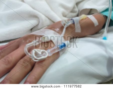 Patient's Hand With Saline Intravenous (iv), Blur Effect