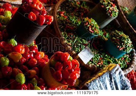Tiny Fresh red green and orange habanero chillies at a local Market in Indonesia