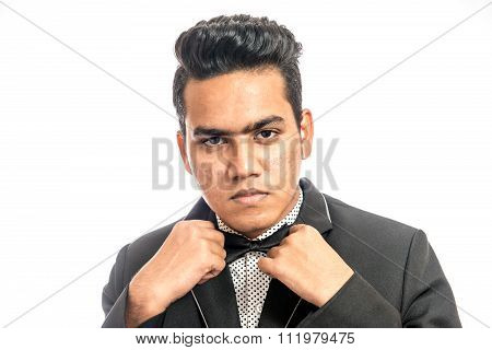Elegant Man In Tuxedo Unbuttoning His Coat