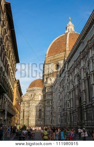 FLORENCE - SEPTEMBER 16: View the Duomo, Famous Santa Maria del Fiore cathedrall  from a street on September 16, 2015 in Florence. It was begun in 1296 and completed in 1436 Firenze, Italy