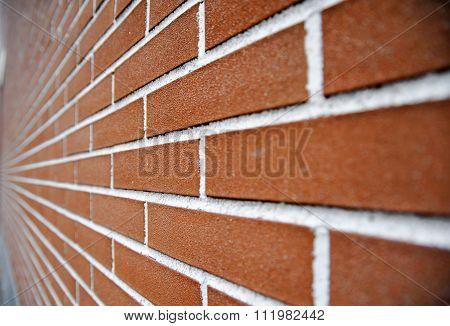 An angled look at a red brick wall