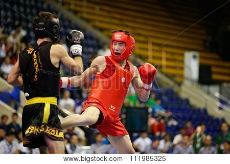 JAKARTA, INDONESIA - NOVEMBER 18, 2015: Hong Xing Kong of China (red) fights Ali Magomedov of Russia (black) in the men's 60kg Sanda final event at the 13th World Wushu Championship 2015.