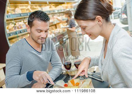 Couple enjoying cheese and wine