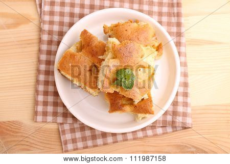 Homemade Apple Pie (charlotte) On A Blue Wooden Background Spruce Branches