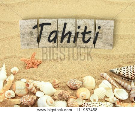 Tahiti on wooden board pieces with sea shells and sand