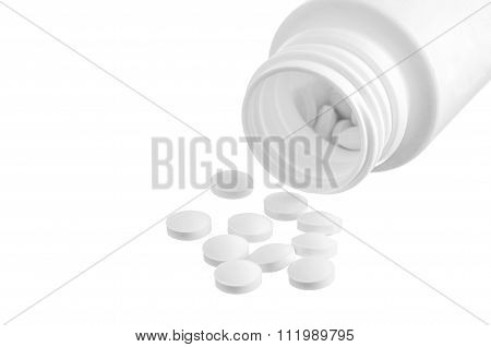 White Pills An Pill Bottle On White Background