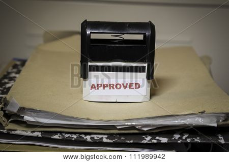 Approved Stamp On A Big Folder Of Paperwork
