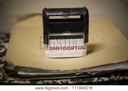 Confidential Stamp On A Big Folder Of Paperwork