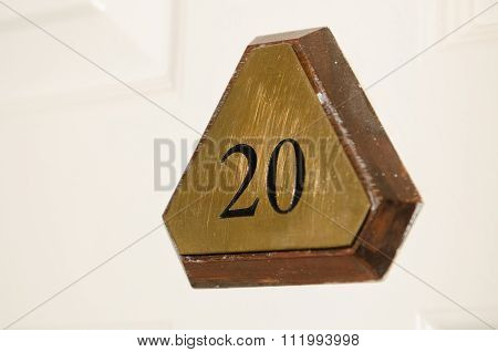 Metal number 20 triangular hotel room door sign