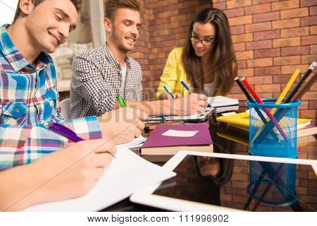 Young Group Working With A Business Project Sitting At The Table