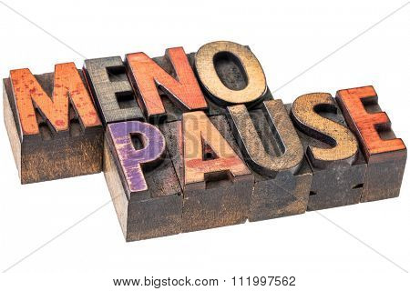 menopause word abstract  - isolated text in vintage wood letterpress printing blocks stained by color inks